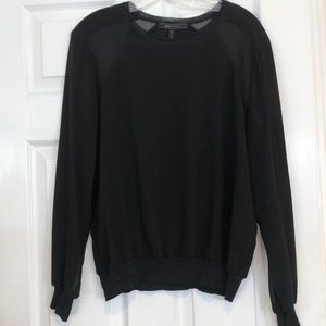 BCBG top with sheer panels on sleeves